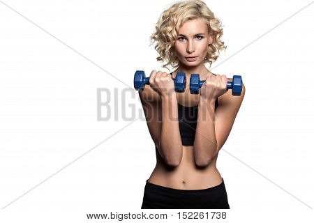 Beautiful Fitness Woman With Lifting Dumbbells . Sporty Girl Showing Her Well Trained Body . Well-de