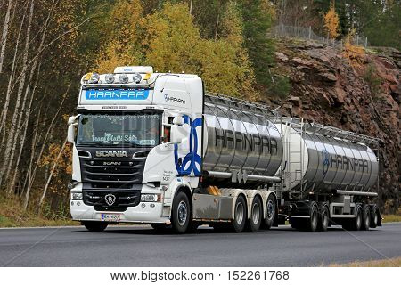 KARJAA, FINLAND - OCTOBER 15, 2016: White super Scania R620 double tanker truck of Trans Matti Salo for Haanpaa moves along highway in autumn in South of Finland.