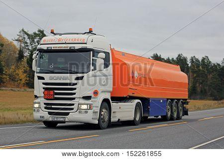 KAARINA FINLAND - OCTOBER 16 2016: New white Scania R400 semi tanker Saint-Petersburg hauls gasoline fuel along highway in autumn.