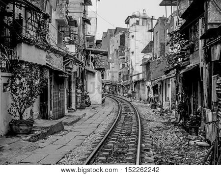 Railway crossing a narrow street in Hanoi, Vietnam