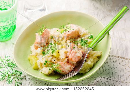 Slow Cooker Salmon Risotto. stile rustic.selective focus