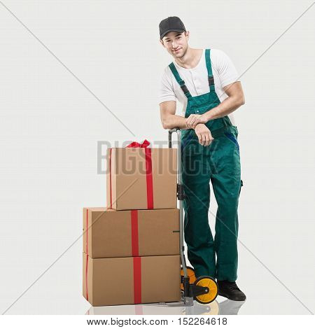 Courier a handcart gift boxes on grey