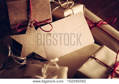 Rustic retro gifts, present boxes with tag for your wishes. Christmas time, vintage mood. Handmade eco paper wrap.