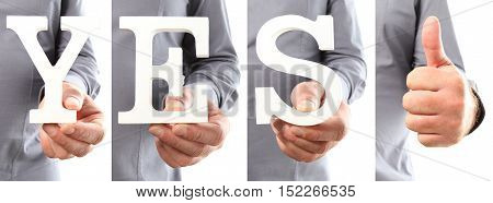 Hands holding letter text yes word and thumb up