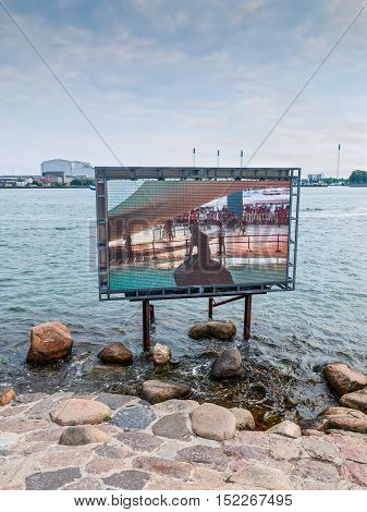 Copenhagen Denmark - August 5 2010: Statue in Copenhagen is not in place as it was taken to an exhibition in China. Sculpture show on the screen from China. The Copenhagen City Council arranged to move the statue to Shanghai at the Danish P
