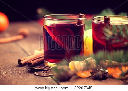 Hot mulled wine with spices and slices of mandarin
