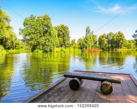 Wooden mooring on the calm forest lake