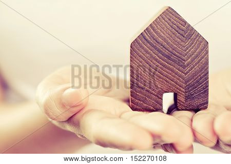 close up image of model house in hands