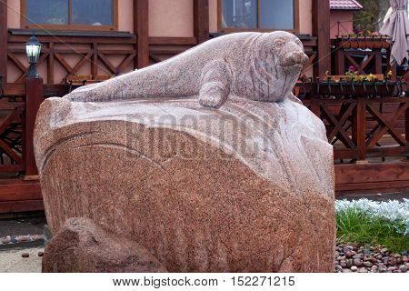 RUSSIA ZELENOGRADSK - OCTOBER 11 2014: Sculpture of the seal Rurik on the Zelenogradsk promenade. In honor of the seal repeatedly appear on the city's beaches. Zelenogradsk (Cranz) is a resort town in Russia on the Baltic Sea.