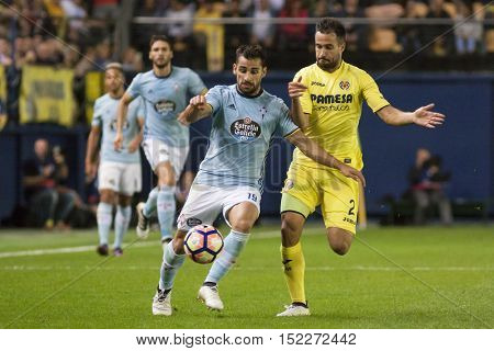 VILLARREAL, SPAIN - OCTOBER 16th: Jonny with ball and Mario during La Liga soccer match between Villarreal CF and R.C. Celta de Vigo at El Madrigal Stadium on October 16, 2016 in Villarreal, Spain