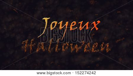 Joyeux Halloween text in French dissolving into dust to bottom