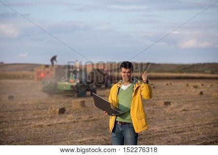 Happy Farmer In Soybean Field