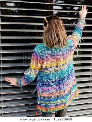 Cool Girl In Colorful Woolen Sweater Posing In Garden