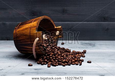 Coffee Beans On Wooden Cask