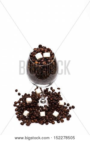 Coffee Beans And Sugar Cubes Inside Wine Glass