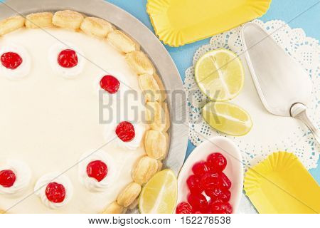 Cheesecake with candied cherries on a blue background