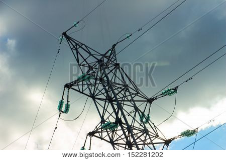 A high voltage power pylons against sky. The photo shows a sky with cloud