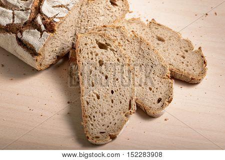 Rye sliced bread on wooden cutting board