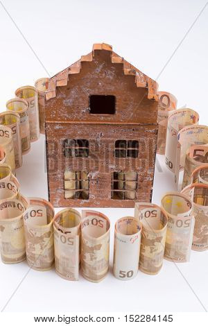 Dream house and mortgage - Euro banknotes - private finance concept payments and problems