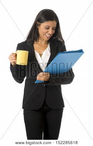 corporate portrait young attractive latin businesswoman in formal office suit smiling happy holding folder and coffee mug standing isolated on white background in business project presentation