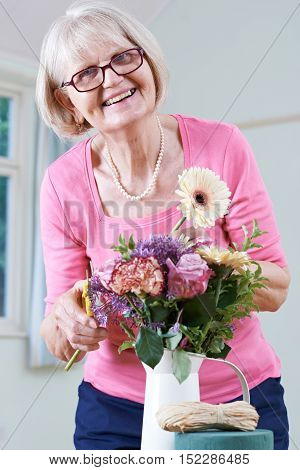 Portrait Of Senior Woman In Flower Arranging Class