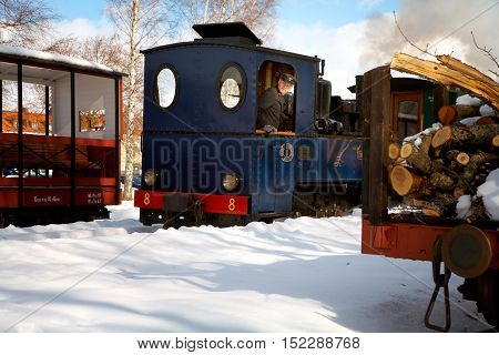 Mariefred, Sweden - March 19, 2006: Winter at the OSLJ puplic accessible museum railroad with steam locomotive number 8 Emsfors switching.