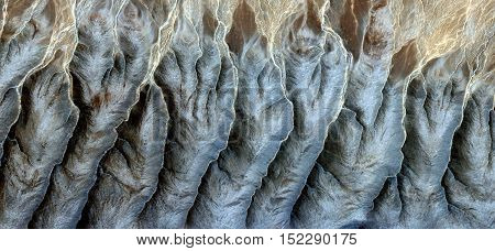 fantasy forms of stone in the desert like Stone barnacles, Abstract photography of landscapes of deserts of Africa from the air