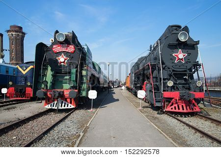 SAINT PETERSBURG RUSSIA - MARCH 30 2016: Two Soviet steam locomotive in the Museum of the Oktyabrskaya railway. Historical landmark of the Saint-Petersburg