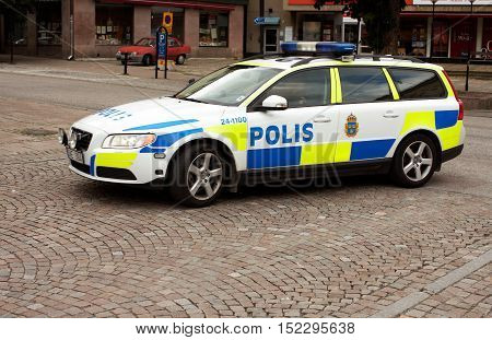 Vasteras, Sweden - September 16 ,2012: Swedish police car with patrolling policemen  inside.