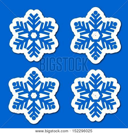Set paper snowflakes with shadow isolated on a blue background. Graphic material and design elements to decorate Christmas cards backgrounds posters vector illustration.