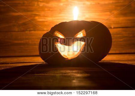Jack O Lanterns Halloween Pumpkin Face On Wooden Background.