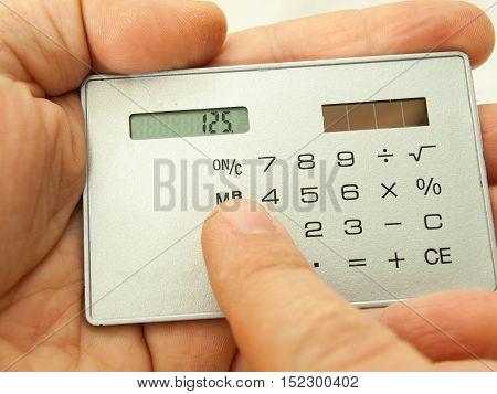 Calculations on the touch mine-calculator which works on solar energy