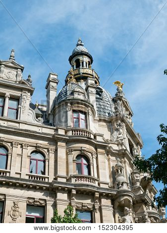 Facade of landmark building along Meir street in Antwerp, Belgium with ornaments and statues