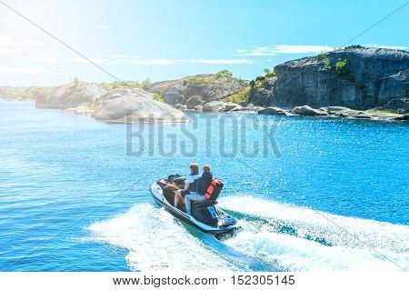 Young guy cruising on a jet ski in North sea