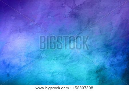 Full frame blue and purple background resembling watercolor painting with copy space