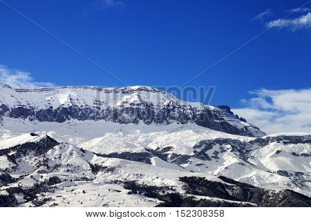 Snowy Mountains And Blue Sky At Nice Sun Winter Day
