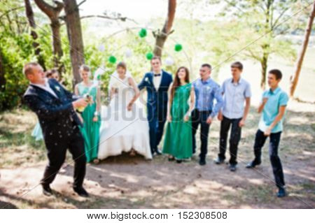 Blur Effect Of Wedding Guests And Friend With Explosion Of Champagne