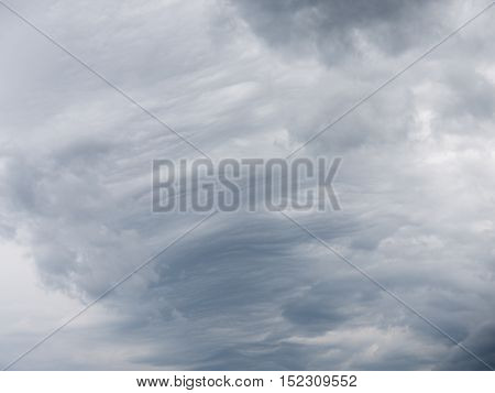 gray cumulus and cirrus clouds mixed in cloudy sky