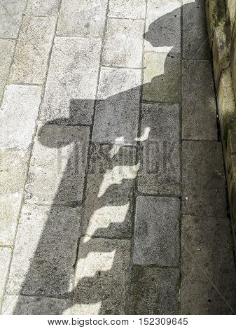 Shade of stone stairs in Santiago de Compostela, Spain