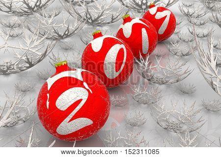 Christmas balls 2017. Christmas balls lying on white surface among the snowflakes and form the inscription