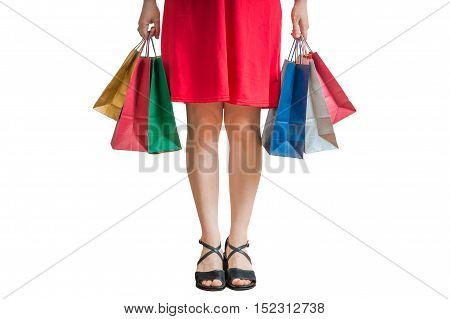 Shopping And Consumerism Concept. Legs Of Young Woman Holding Sh