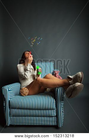Young Woman With Soap Bubbles
