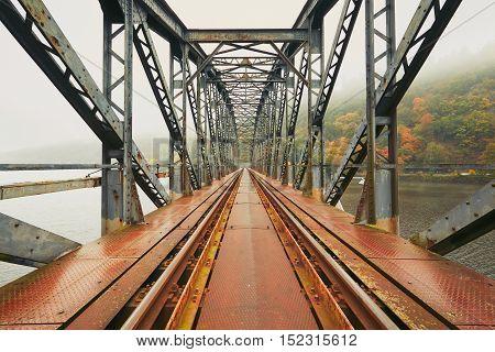 Foggy morning. Old railway bridge in amazing autumn landscape in the Czech Republic