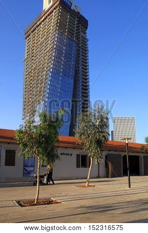 TEL AVIV, ISRAEL - APRIL 7, 2016: View of open air commercial center Sarona and skyscrapers, Tel Aviv, Israel. Open Sarona Market became most popular place in Tel Aviv.
