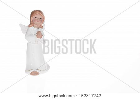 Little white guardian angel over white background. Vintage style christmas decoration