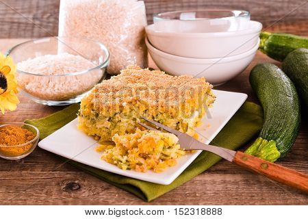 Rice timbale with zucchini on white dish.