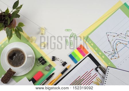 Business blank, notepad, coffee cup and pen at office desk table top view. Corporate stationery branding mock-up. Copy space for text.