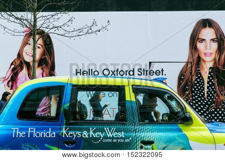 LONDON, UK - April 08, 2015: Oxford Street. billboard on the street hello Oxford Street