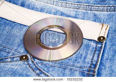 compact disk with modern music against fashionable blue jeans