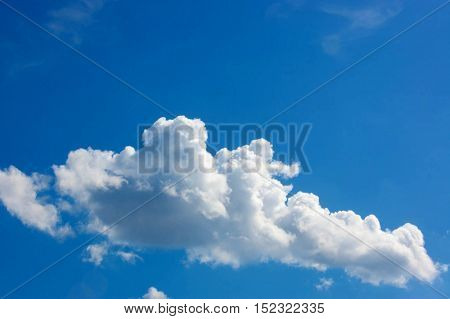 Fluffy white clouds with a background of beautiful blue sky